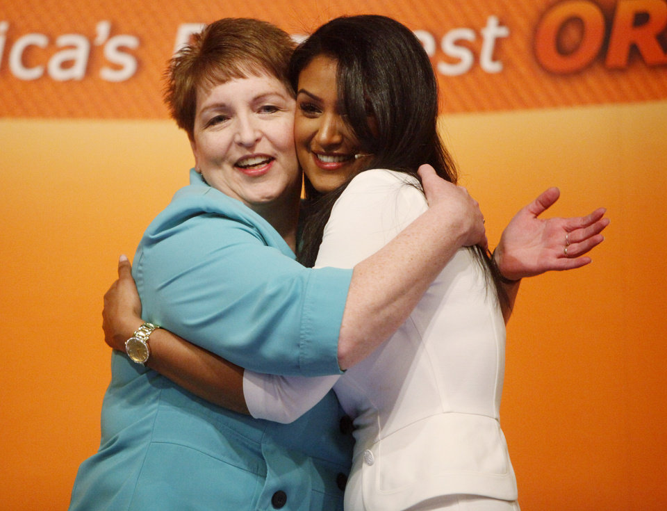 Photo -  2014 Miss America, Nina Davuluri, is hugged by her third-grade teacher, Mary Hatcher of Homer Elementary School in Ada, after giving a speech to Stillwater third-grade students Thursday at the Wes Watkins Center. Davuluri lived part of her childhood in Ada, before eventually moving to New York. Photo by KT King, for The Oklahoman   KT King -  KT King, The Oklahoman