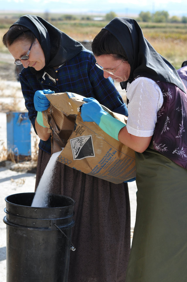 Photo -   This undated image released by National Geographic Channels shows Hutterites Rita Hofer and Sarah Hofer pouring lye for soap in King Colony, Mont.