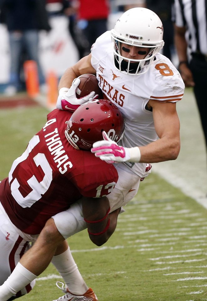 Photo - Oklahoma's Ahmad Thomas (13) takes down Texas' Jaxon Shipley (8) after a catch during the Red River Showdown college football game between the University of Oklahoma Sooners (OU) and the University of Texas Longhorns (UT) at the Cotton Bowl in Dallas, Texas on Saturday, Oct. 11, 2014. Photo by Steve Sisney, The Oklahoman