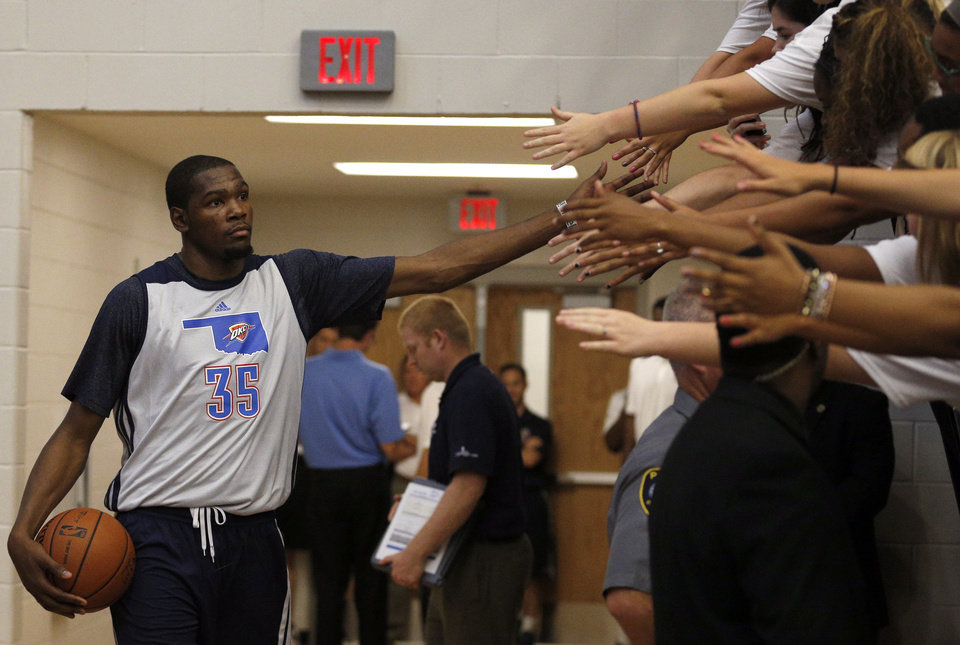 Photo - Oklahoma City Thunder's Kevin Durant greets fans before the Oklahoma City Thunder's Blue and White scrimmage at Westmoore High School in Moore, Okla., Sunday, Oct. 13, 2013. PHOTO BY SARAH PHIPPS, The Oklahoman