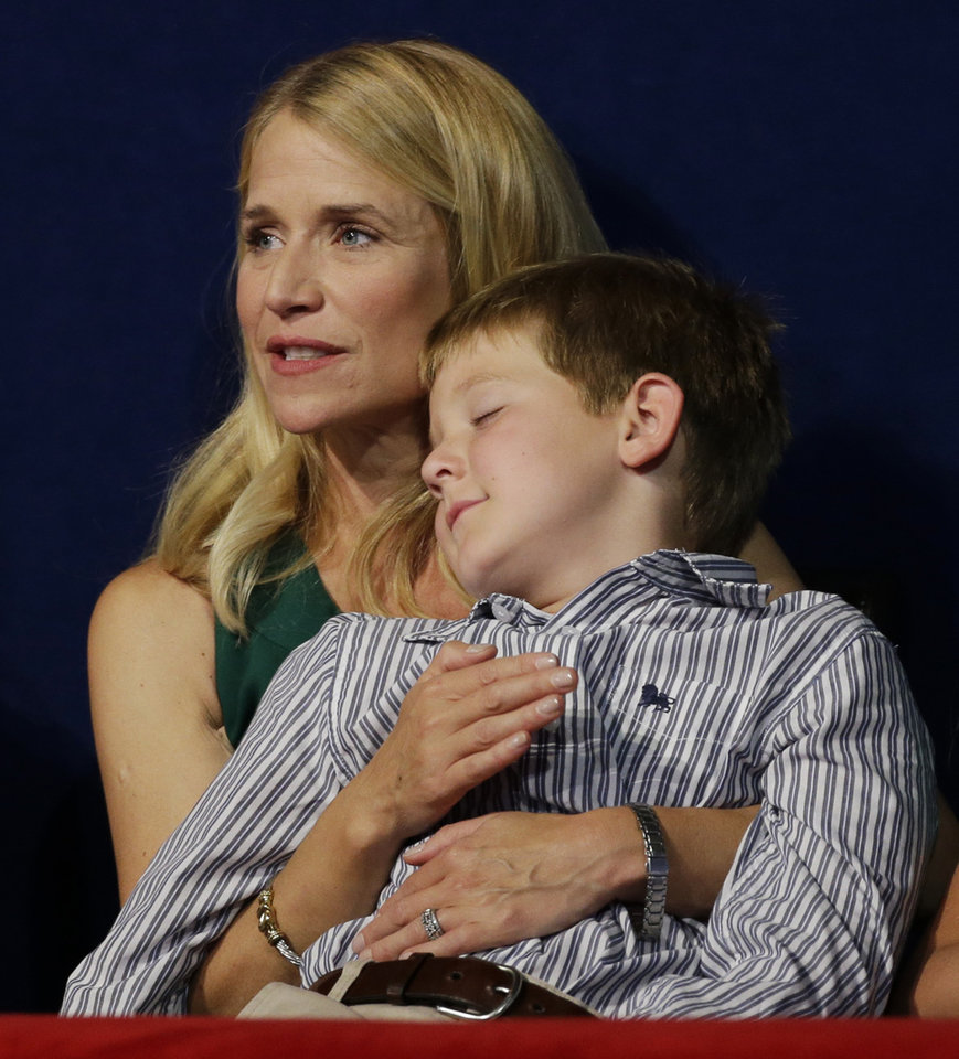 Photo -   Sam Ryan sleeps in his mother's arms while Republican vice presidential nominee, Rep. Paul Ryan speaks during the Republican National Convention in Tampa, Fla., on Wednesday, Aug. 29, 2012. (AP Photo/Charlie Neibergall)