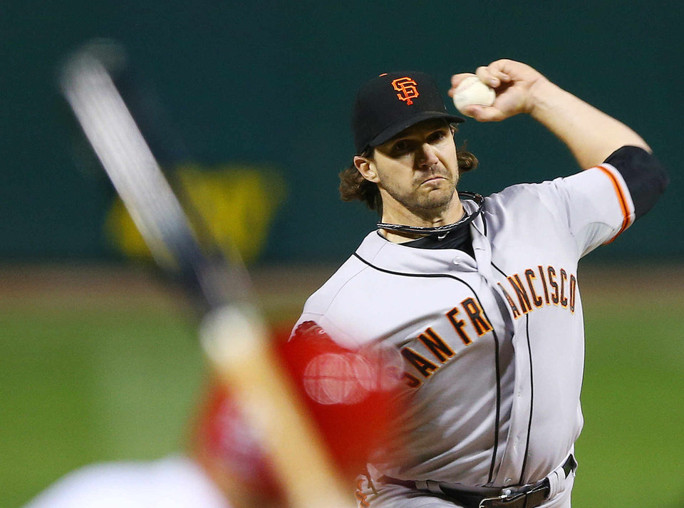Photo -   San Francisco Giants starting pitcher Barry Zito throws during the first inning of Game 5 of baseball's National League championship series against the St. Louis Cardinals, Friday, Oct. 19, 2012, in St. Louis. (AP Photo/Elsa, Pool)