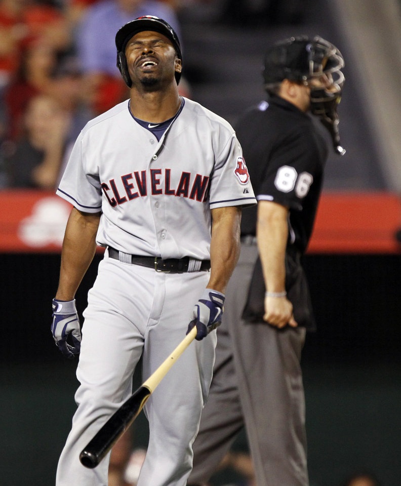 Photo - Cleveland Indians' Michael Bourn rues striking out with two runners on base to end the fifth inning of a baseball game against the Los Angeles Angels on Tuesday, April 29, 2014, in Anaheim, Calif. (AP Photo/Alex Gallardo)