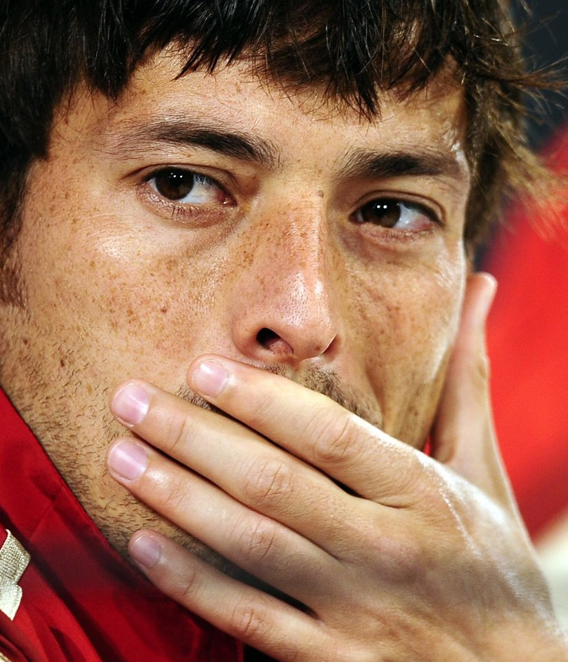Photo - Spain's David Silva, looks on during a press conference  of the Spanish national soccer team at the Atletico Paranaense training center in Curitiba, Brazil, Monday, June 9, 2014. Spain will play in group B of the Brazil 2014 World Cup. (AP Photo/Manu Fernandez)