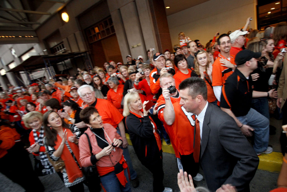 Photo - OSU head coach Mike Gundy loads the team bus during the Spirit Walk before the Valero Alamo Bowl college football game between the Oklahoma State University Cowboys and the University of Arizona Wildcats at the Alamodome in San Antonio, Texas, Wednesday, December 29, 2010. Photo by Sarah Phipps, The Oklahoman