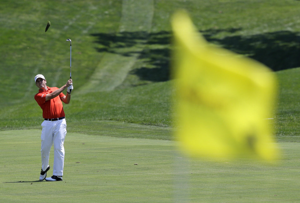 Photo - Ben Martin is seen past the first pin as he hits from the fairway during the final round of the Quicken Loans National PGA golf tournament, Sunday, June 29, 2014, in Bethesda, Md. (AP Photo/Patrick Semansky)