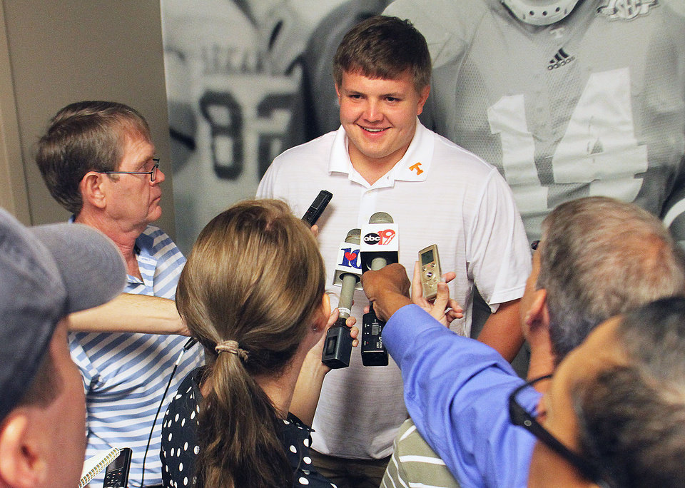 Photo - University of Tennessee football offensive lineman Mack Crowder answers questions at Neyland Stadium at the University of Tennessee Football Media Day Thursday, July 31, 2014 in Knoxville, Tenn. (AP Photo/The Daily Times, Tom Sherlin)