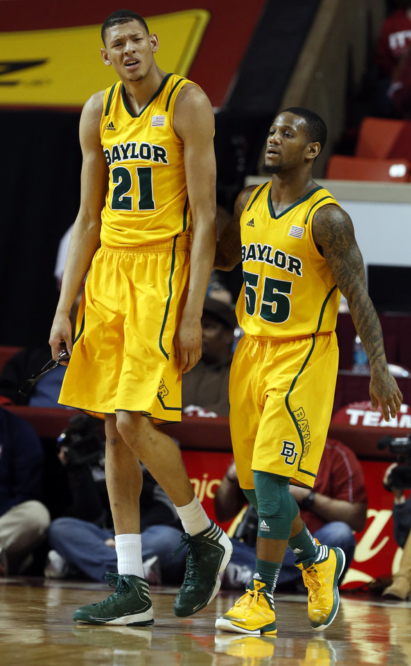 Baylor Bear's Isaiah Austin and Pierre Jackson react to play in the first half as the University of Oklahoma Sooners (OU) men play the Baylor University Bears (BU) in NCAA, college basketball at The Lloyd Noble Center on Saturday, Feb. 23, 2013  in Norman, Okla. Photo by Steve Sisney, The Oklahoman