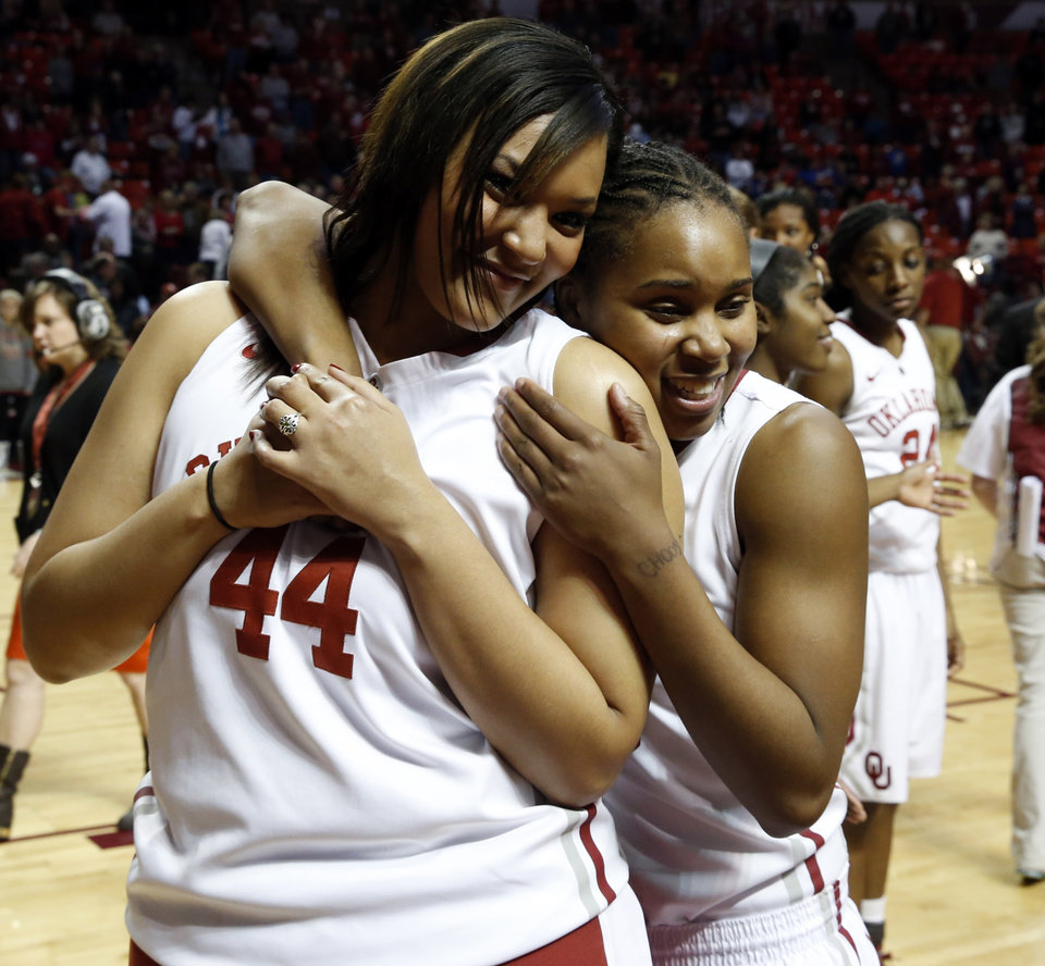 Photo - Oklahoma Sooners Lyndsey Cloman (44) and Jasmine Hartman embrace at the Senior Day ceremony after the University of Oklahoma Sooners (OU) defeated the Kansas Jayhawks 85-77 in NCAA, women's college basketball at The Lloyd Noble Center on Saturday, March 2, 2013  in Norman, Okla. Photo by Steve Sisney, The Oklahoman