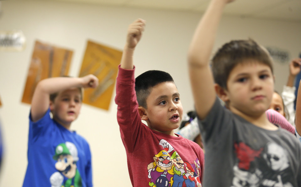 First-grader Imanol Mendez practices for an upcoming musical program at  Putnam City's Western Oaks Elementary. PHOTO BY SARAH PHIPPS, THE OKLAHOMAN.   <strong>SARAH PHIPPS - THE OKLAHOMAN</strong>