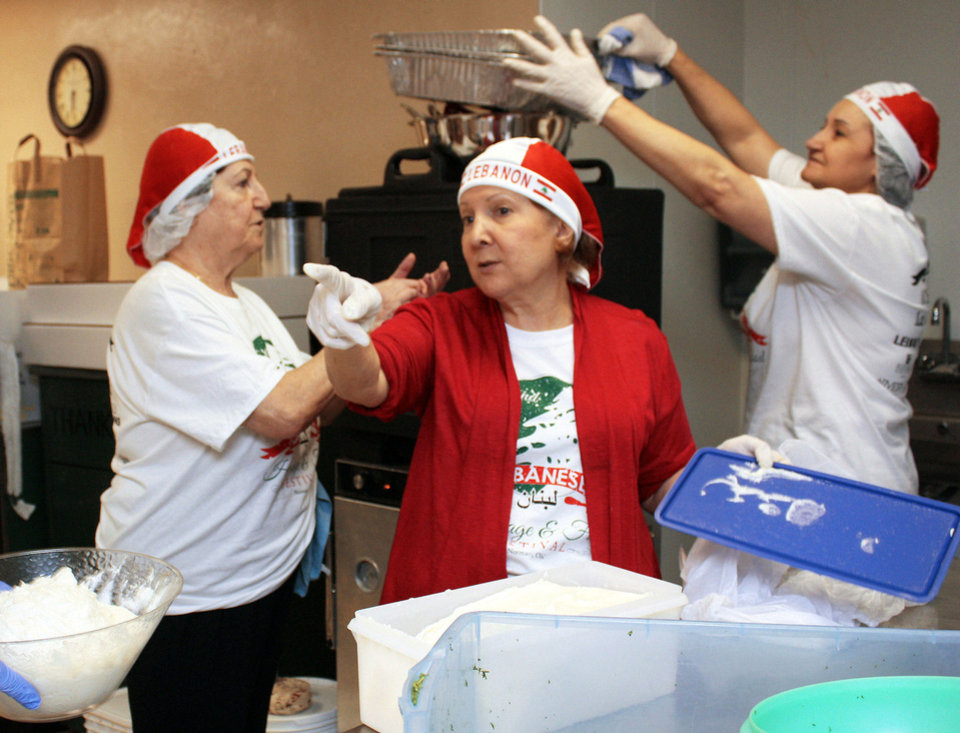 Photo - From left, Najat Mondalek, Sue Salieb and Siham Toubia prepare food for the Lebanese heritage festival sponsored by Our Lady of Lebanon Maronite Catholic Church. PHOTO BY LYNETTE LOBBAN, FOR THE OKLAHOMAN