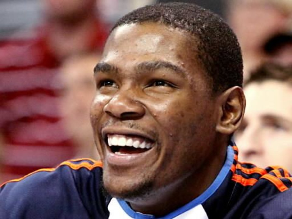 After being pulled from the game in the fourth quarter, Oklahoma City's  Kevin  Durant smiles as he watches the Thunder beat Toronto during their NBA basketball game at the Ford Center in Oklahoma City on Sunday, Feb. 28, 2010. The Thunder beat the Raptors 119-99. Photo by John Clanton