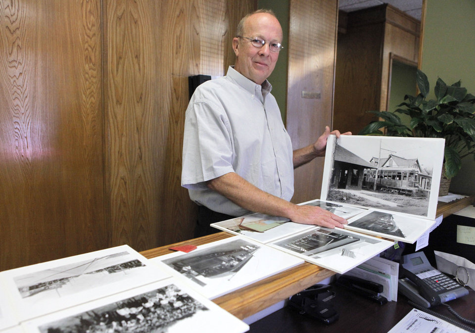 Barry Rice looks at old photos of the interurban depot he uncovered when he started renovating one of his buildings in downtown Edmond. He decided to tear down newer parts of the building at 9 E First, leaving only the remains of the trolley car station, which dates to the 1920s. BY DAVID MCDANIEL, THE OKLAHOMAN <strong>David McDaniel - The Oklahoman</strong>