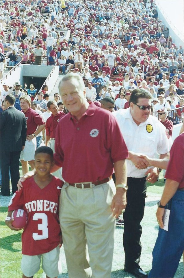 Sterling Shepard, left, with former OU coach Barry Switzer before a Sept. 23, 2000, game against Rice during which the 1985 Oklahoma championship team was honored. Sterling\'s father, Derrick Shepard, played on the 1985 team. PHOTO PROVIDED
