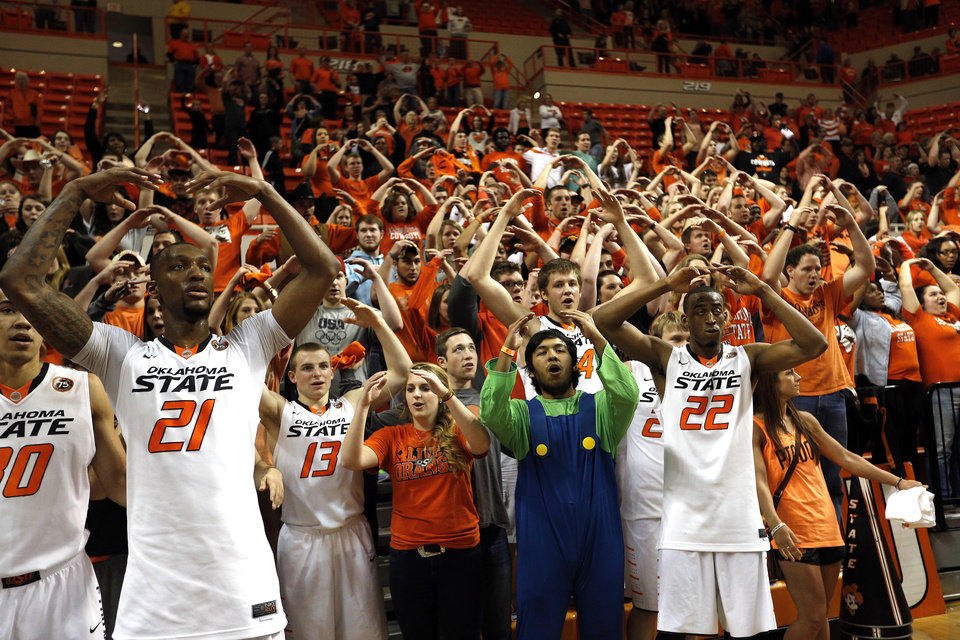 Photo - Oklahoma State celebrates with fans following the men's college basketball game between Oklahoma State and Texas Tech at Gallagher-Iba Arena in Stillwater, Okla., Saturday, Feb. 22, 2014. OSU won 84-62.  Photo by Sarah Phipps, The Oklahoman