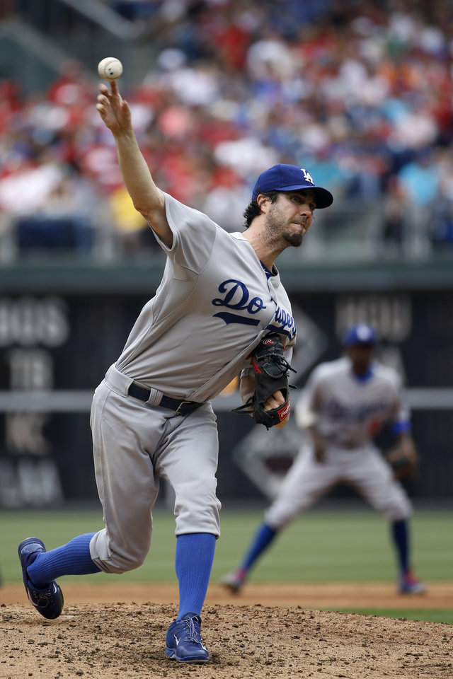 Photo - Los Angeles Dodgers' Dan Haren pitches during the second inning of a baseball game against the Philadelphia Phillies, Saturday, May 24, 2014, in Philadelphia. (AP Photo/Matt Slocum)