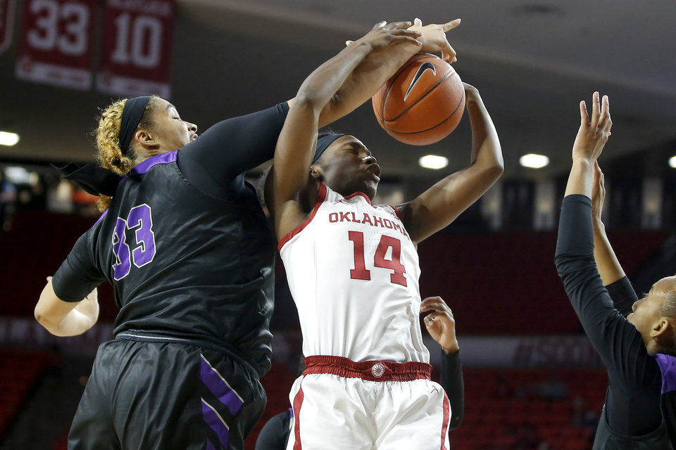 Photo - Oklahoma's Shaina Pellington (14) goes for a rebound beside Central Arkansas' Alexyse Thomas (33) during an NCAA women's basketball game between the University of Oklahoma (OU) and Central Arkansas at Loyd Noble Center in Norman, Okla., Wednesday, Dec. 5, 2018. Photo by Bryan Terry, The Oklahoman