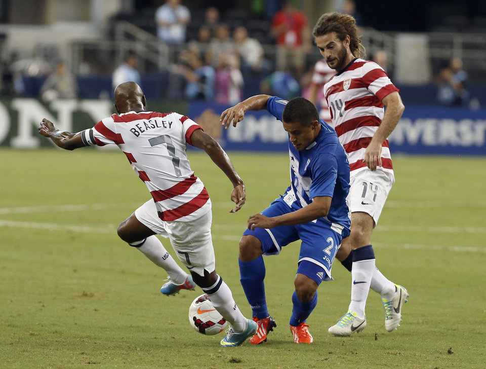 Photo - Honduras' Roger Rojas (21) battles United States' DaMarcus Beasley (7) and Kyle Beckerman (14) for control of the ball during the first half of the Gold Cup semifinals at Cowboys Stadium, Wednesday, July 24, 2013, in Arlington, Texas. (AP Photo/Brandon Wade)