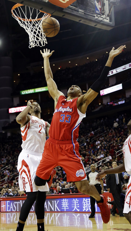 Los Angeles Clippers' Grant Hill (33) reacts after being fouled by Houston Rockets' Marcus Morris (2) during the second quarter of an NBA basketball game, Tuesday, Jan. 15, 2013, in Houston. (AP Photo/David J. Phillip)