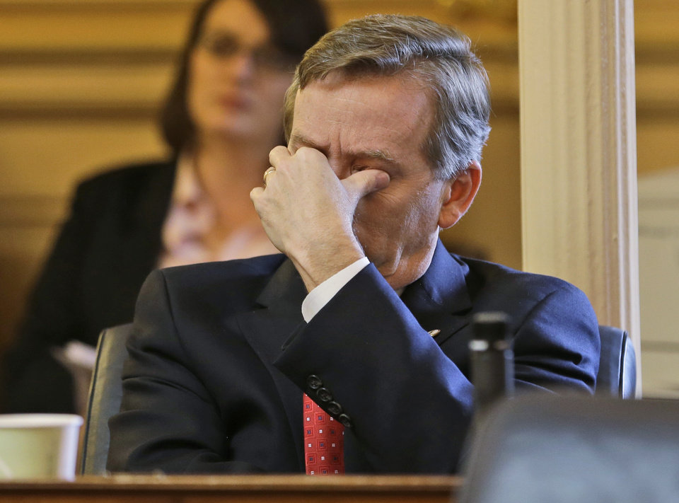 Del. Chris Jones, R-Suffolk, wipes his eyes during debate on a committee report on the transportation funding bill on the floor of the House at the Capitol in Richmond, Va., Friday, Feb. 22, 2013.   The House passed the bill. (AP Photo/Steve Helber)