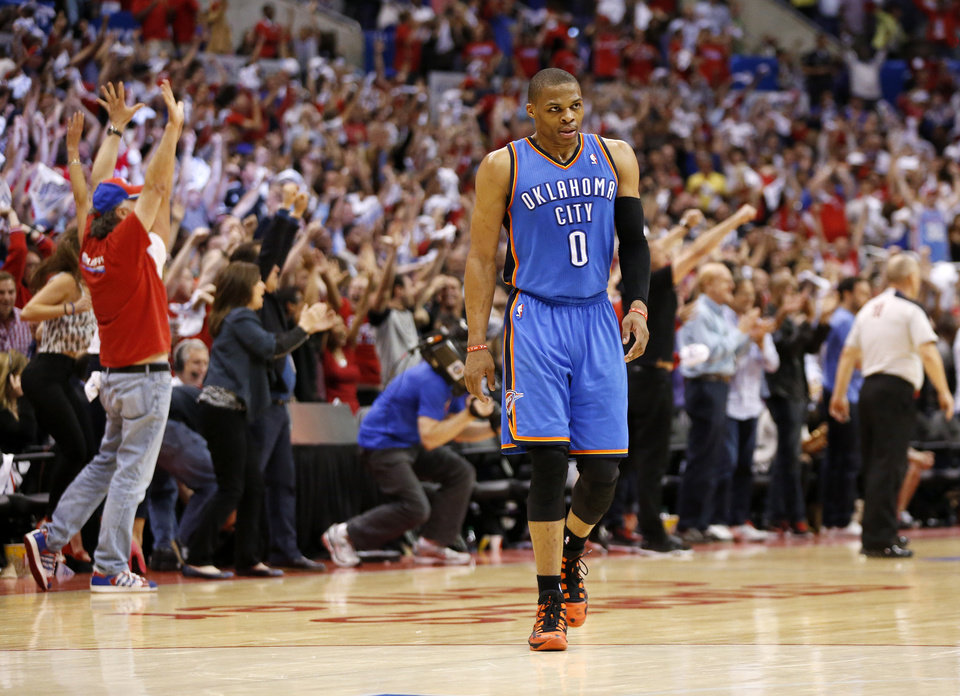 Photo - Oklahoma City's Russell Westbrook (0) leaves the floor at the end of Game 4 of the Western Conference semifinals in the NBA playoffs between the Oklahoma City Thunder and the Los Angeles Clippers at the Staples Center in Los Angeles, Sunday, May 11, 2014. The Clippers won 101-99. Photo by Nate Billings, The Oklahoman