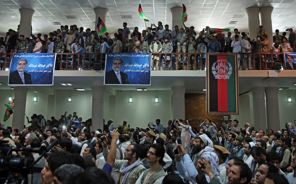 Photo - Supporters of Afghan presidential candidate Abdullah Abdullah listen to  his speech at a gathering in Kabul, Afghanistan, Tuesday, July 8, 2014. Abdullah says he received calls from President Barack Obama and U.S. Secretary of State John Kerry after he refused to accept the preliminary result of the vote citing fraud. Abdullah told his supporters the results of the election were fraudulent but asked them to give him a few more days to negotiate. (AP Photo/Massoud Hossaini)