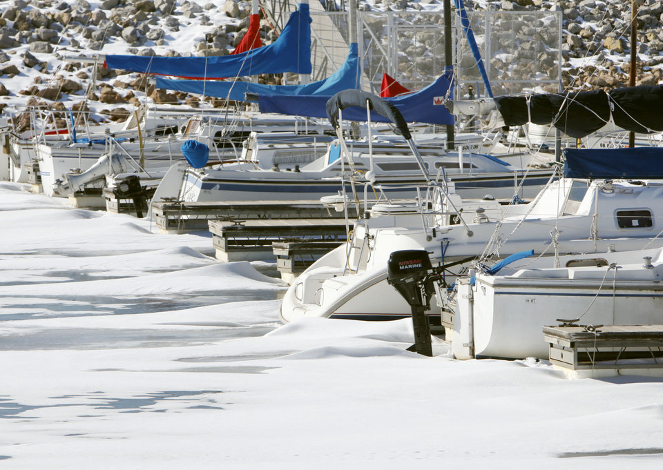 Photo - Sailboats are frozen in ice at Lake Hefner in Oklahoma City, OK, Thursday, Feb. 10, 2011. By Paul Hellstern, The Oklahoman