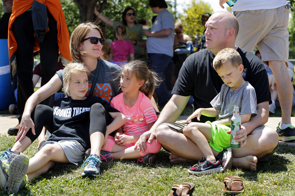 Photo - Rick and Dallas Park, their children Lennon, left, and Drew, and niece Brinley Buchholz, lesten to North Meets West during the Norman Music Festival on Saturday, April 26, 2014 in Norman, Okla.  Photo by Steve Sisney, The Oklahoman