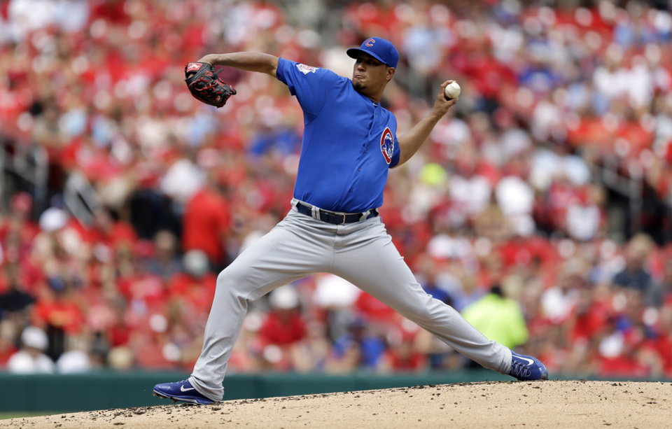 Photo - Chicago Cubs starting pitcher Felix Doubront throws during the first inning in the first baseball game of a doubleheader against the St. Louis Cardinals, Saturday, Aug. 30, 2014, in St. Louis. (AP Photo/Jeff Roberson)