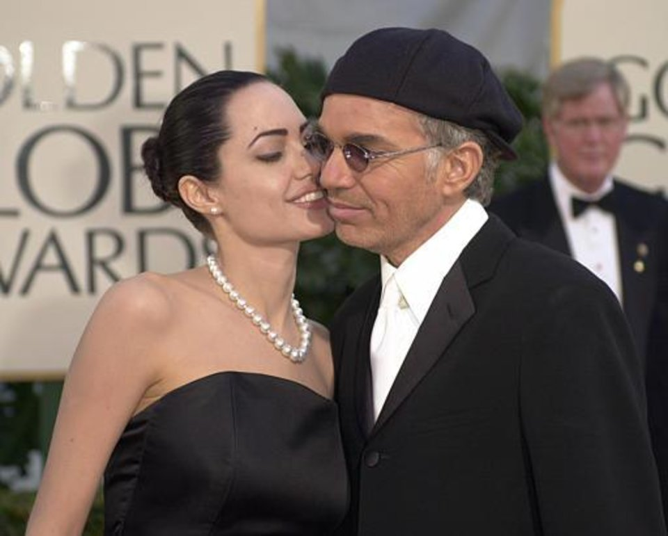 Actor Billy Bob Thornton arrives with his wife, actress Angelina Jolie, for the 59th Annual Golden Globe Awards in Beverly Hills, Calif., Sunday, Jan. 20, 2002. Thornton is nominated twice for best actor roles for his work in  The Man Who Wasn t There  and  Bandits.  (AP Photo/Kevork Djansezian)