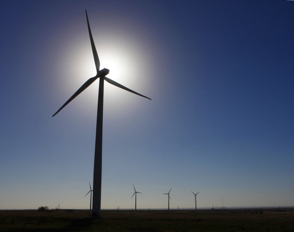 Photo - Wind turbines spin south of Weatherford in 2012.  David McDaniel - File Photo
