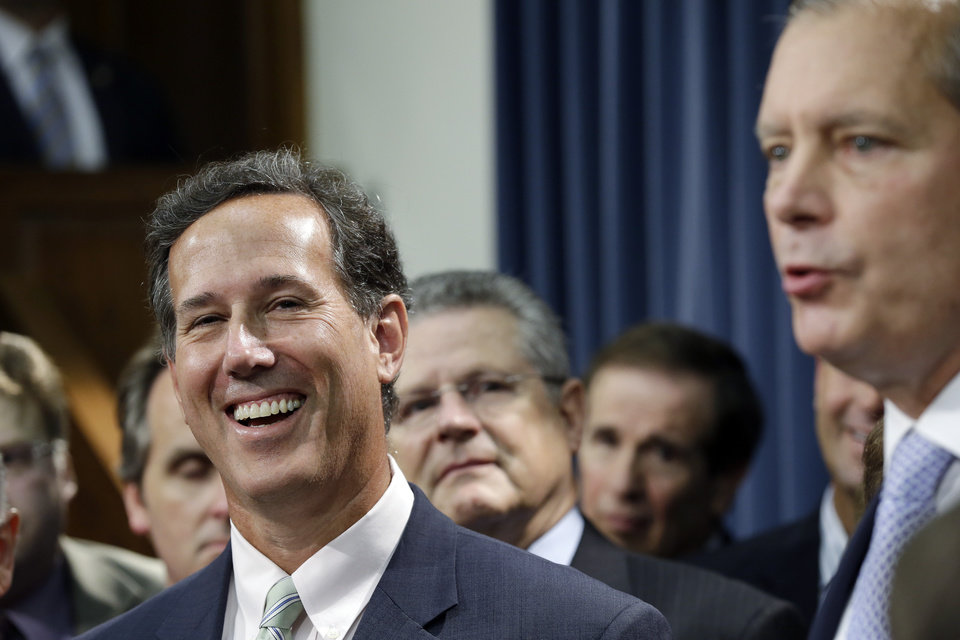 Former Pennsylvania Sen. Rick Santorum, left, listens to Lt. Governor David Dewhurst, right, during a news conference outside the Senate Chambers, Thursday, July 11, 2013, in Austin, Texas.  A Senate committee on Thursday pushed through new abortion restrictions, setting up a Senate vote before the weekend to send it to Gov. Rick Perry. The bill would require doctors to have admitting privileges at nearby hospitals, only allow abortions in surgical centers, dictate when abortion pills are taken and ban abortions after 20 weeks. (AP Photo/Eric Gay)