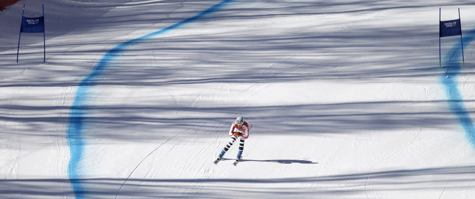 Photo - Germany's Maria Hoefl-Riesch approaches the finish area in a women's downhill training run for the Sochi 2014 Winter Olympics, Friday, Feb. 7, 2014, in Krasnaya Polyana, Russia. (AP Photo/Gero Breloer)