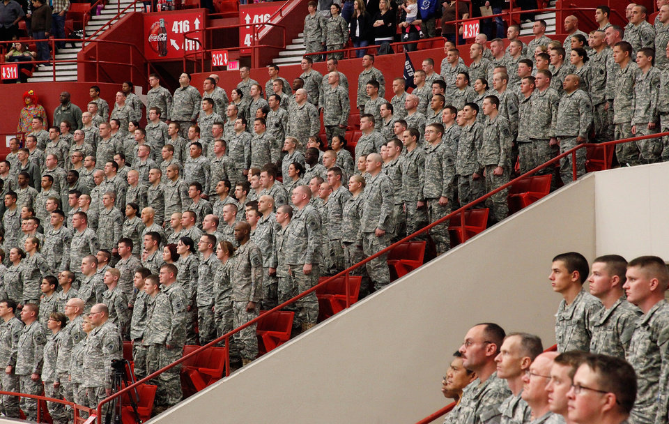 Photo - Troops stand at attention during the playing of the national anthem during the 45th Infantry Brigade Combat Team deployment ceremony inside the Cox Convention Center,  Wednesday, Feb. 16, 2011.  Photo by Jim Beckel, The Oklahoman