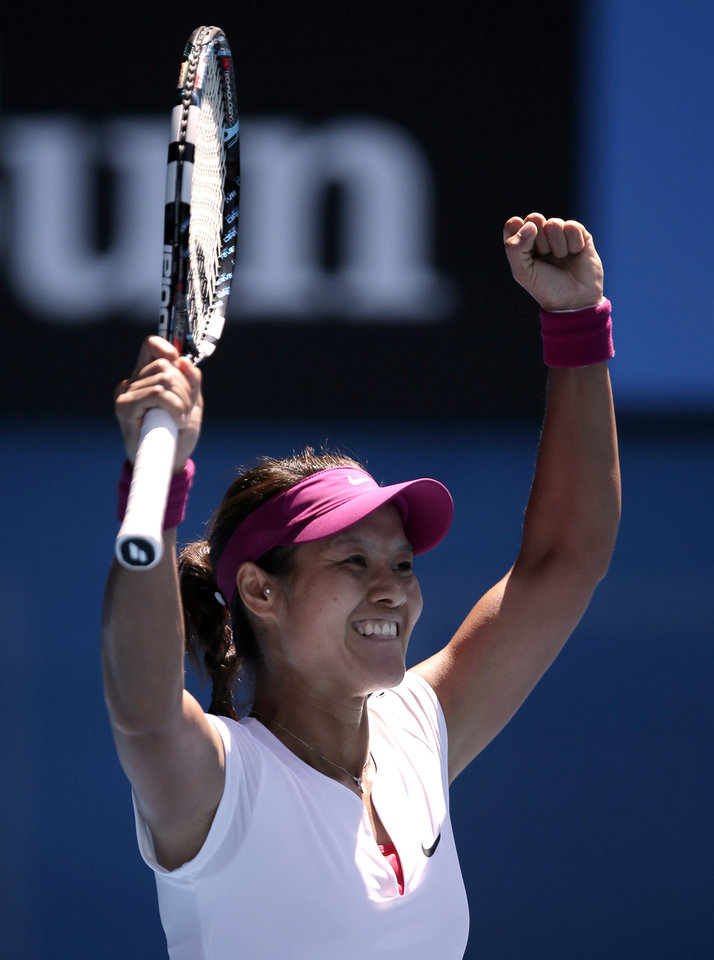 Photo - Li Na of China celebrates after defeating Eugenie Bouchard of Canada during their semifinal at the Australian Open tennis championship in Melbourne, Australia, Thursday, Jan. 23, 2014.(AP Photo/Rick Rycroft)