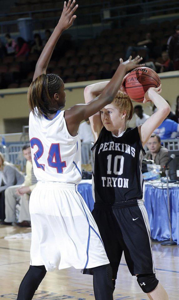 Millwood\'s Raven Prince (24) defends on Perkins\' Bailey Wensler (10) during the state high school basketball tournament Class 3A girls semifinal game between Millwood High School and Perkins High School at the State Fair Arena on Friday, March 8, 2013, in Oklahoma City, Okla. Photo by Chris Landsberger, The Oklahoman