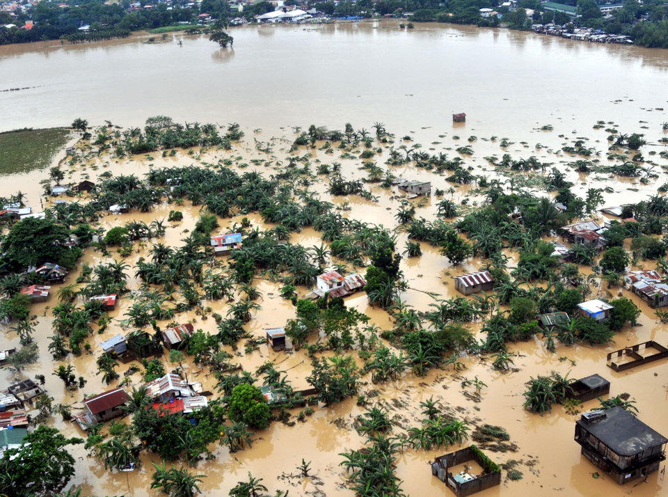 This photo released on Wednesday, Aug. 8, 2012 by the Department of National Defense shows flooded areas in Bulacan province, northern Philippines. Widespread flooding battered a million others and paralyzed the Philippine capital began to ease Wednesday as cleanup and rescue efforts focused on a large number of distressed residents, some still marooned on their roofs. (AP Photo/Department of National Defense) ORG XMIT: XAF807