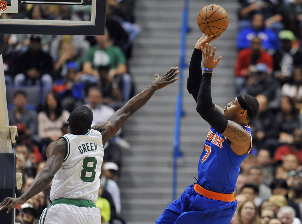 New York Knicks' Carmelo Anthony, right, shoots a basket while guarded by Boston Celtics' Jeff Green, left, in the first half of an NBA preseason basketball game Saturday, Oct. 13, 2012, in Hartford, Conn. (AP Photo/Jessica Hill)