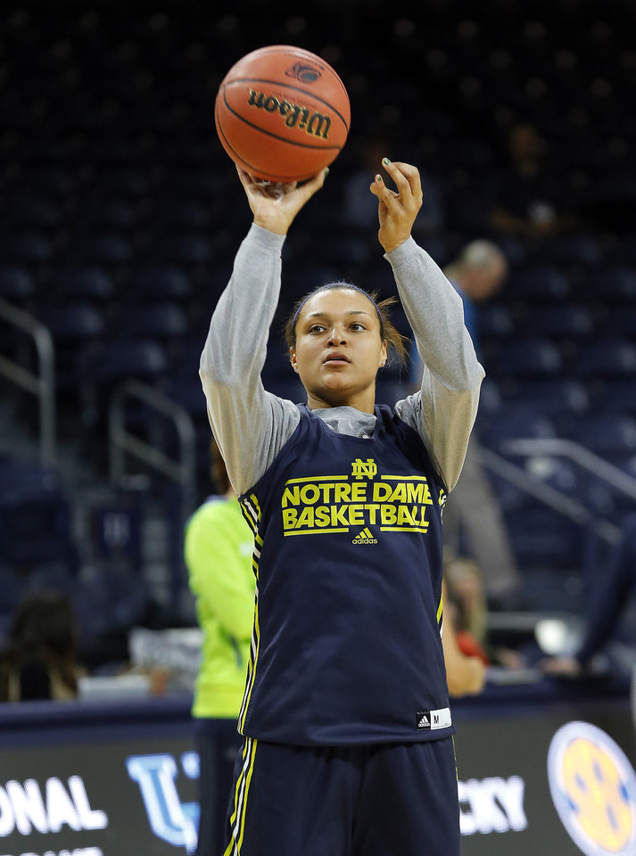 Photo - Notre Dame guard Kayla McBride shoots during their NCAA women's college basketball tournament practice at the Purcell Pavilion in South Bend, Ind., Friday, March 28, 2014. Notre Dame plays Oklahoma State Saturday. (AP Photo/Paul Sancya)