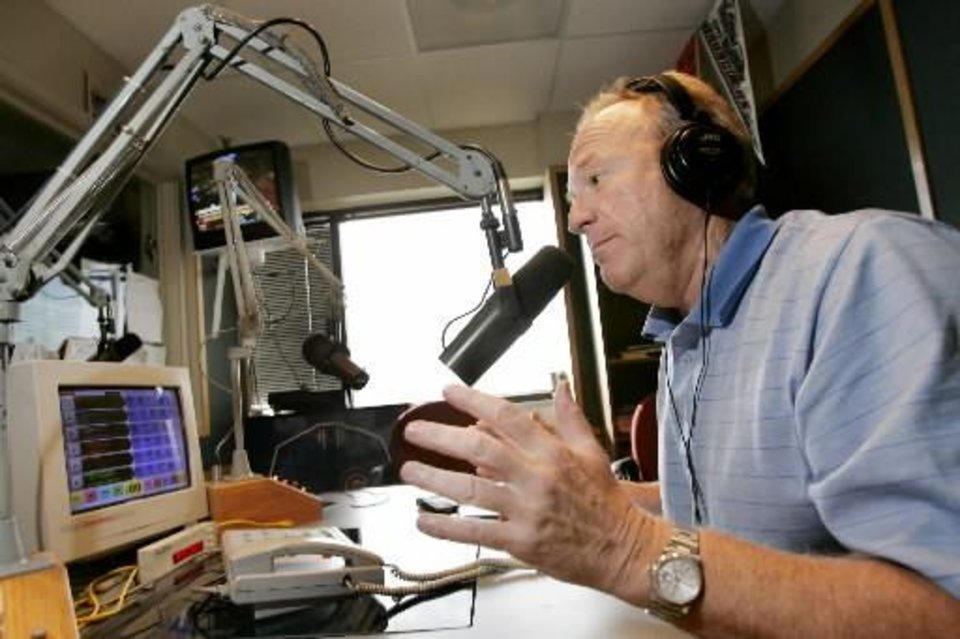 Photo - Jack Mildren, former Lt. Governor and OU quarterback, talks on the air at the WWLS studios in OKlahoma City, October 19, 2005. Photo by Bryan Terry