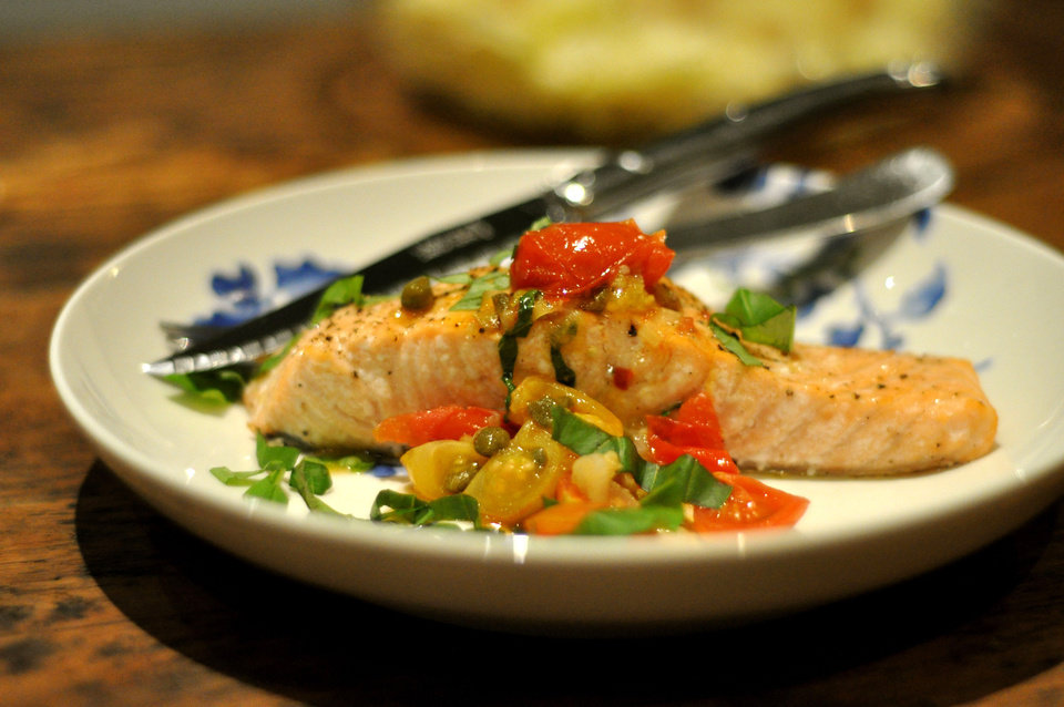 Photo - Even in the winter months, skillet-cooked cherry tomatoes make a sweet salsa for salmon. (Ellise Pierce/Fort Worth Star-Telegram/MCT)
