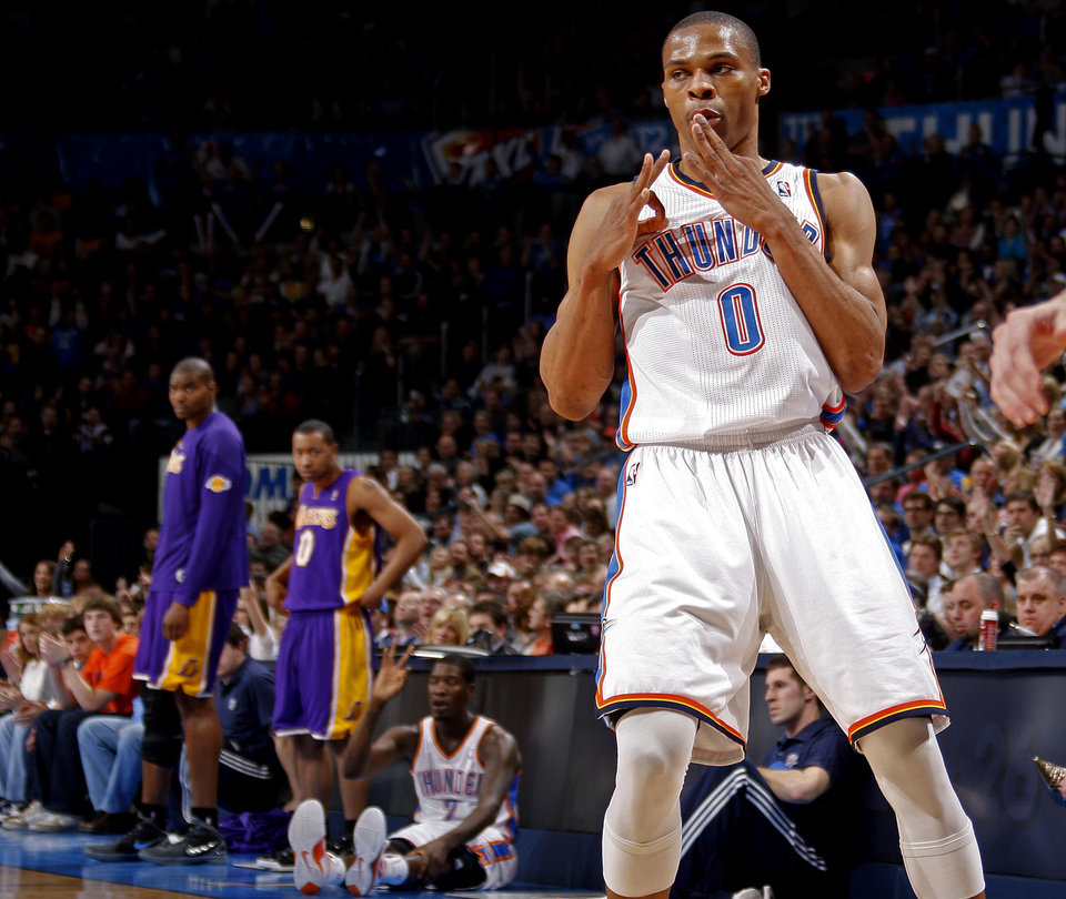 Oklahoma City's Russell Westbrook (0) celebrates after a basket during an NBA basketball game between the Oklahoma City Thunder and the Los Angeles Lakers at Chesapeake Energy Arena in Oklahoma City, Thursday, Feb. 23, 2012. Photo by Bryan Terry, The Oklahoman