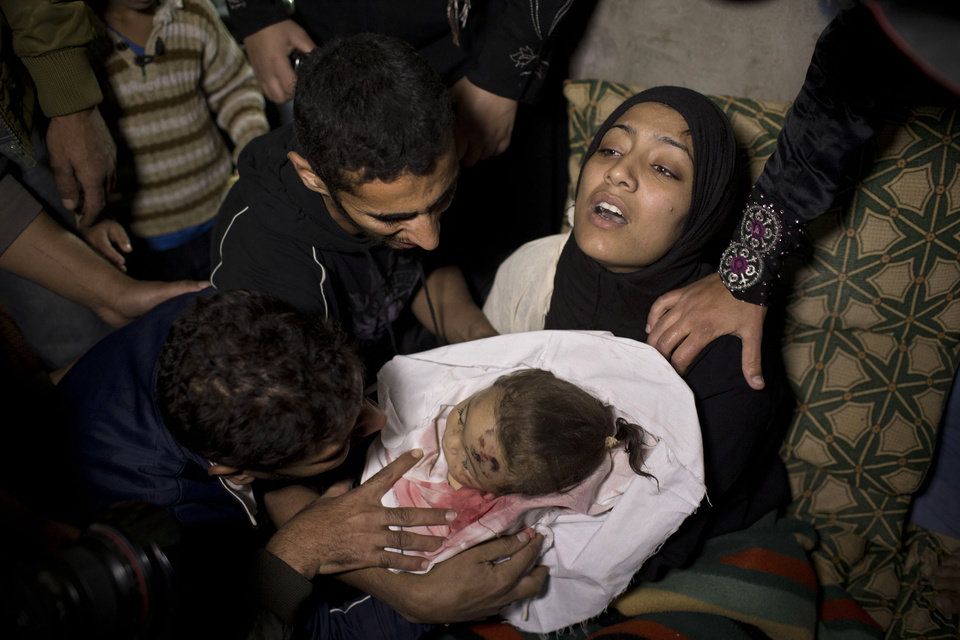 The mother of 10-month-old Palestinian infant Haneen Tafesh holds the dead body of her daughter prior to a funeral in Jabaliya, north Gaza, Friday, Nov. 16, 2012. According to hospital reports Tafesh died from wounds of an earlier Israeli strike. (AP Photo/Bernat Armangue)