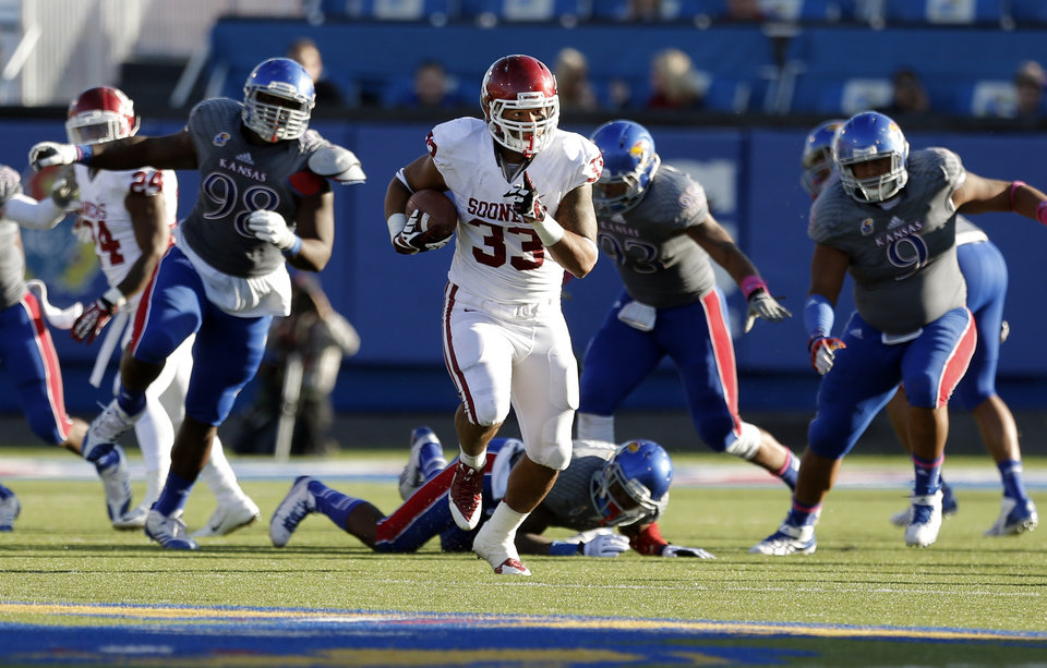 OU's Trey Millard (33) out runs the Kansas defense in the third quarter during of the college football game between the University of Oklahoma Sooners (OU) and the University of Kansas Jayhawks (KU) at Memorial Stadium in Lawrence, Kan., Saturday, Oct. 19, 2013. OU won 34-19. Photo by Sarah Phipps, The Oklahoman