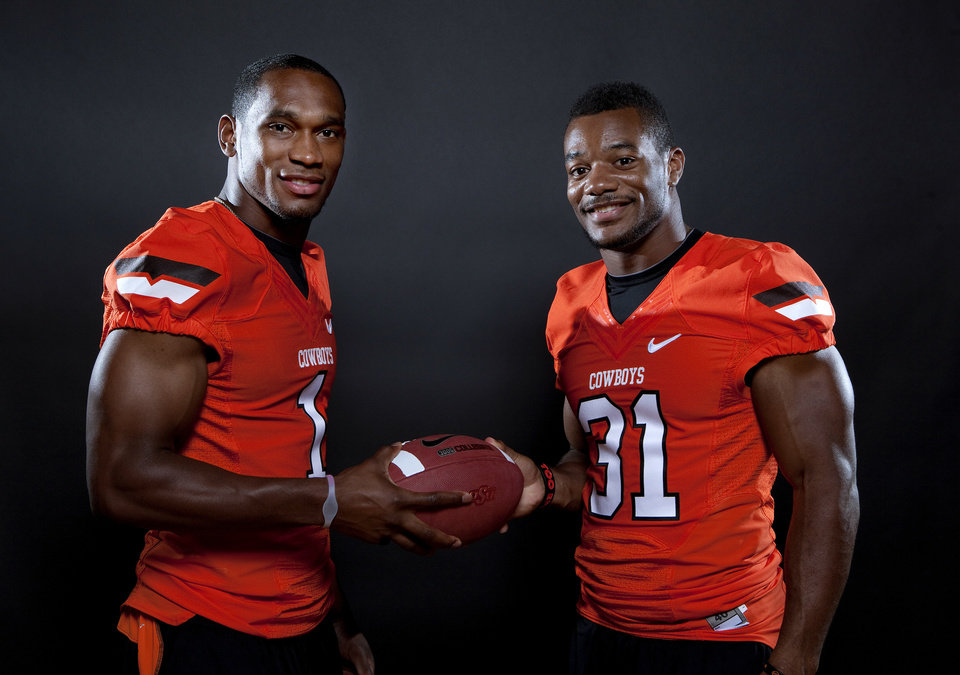 Photo - Oklahoma State's Joseph Randle (1) and eremy Smith (31) pose for a photo during Oklahoma State's Football media day at  in Stillwater, Okla., Saturday, Aug. 6, 2011. Photo by Sarah Phipps, The Oklahoman