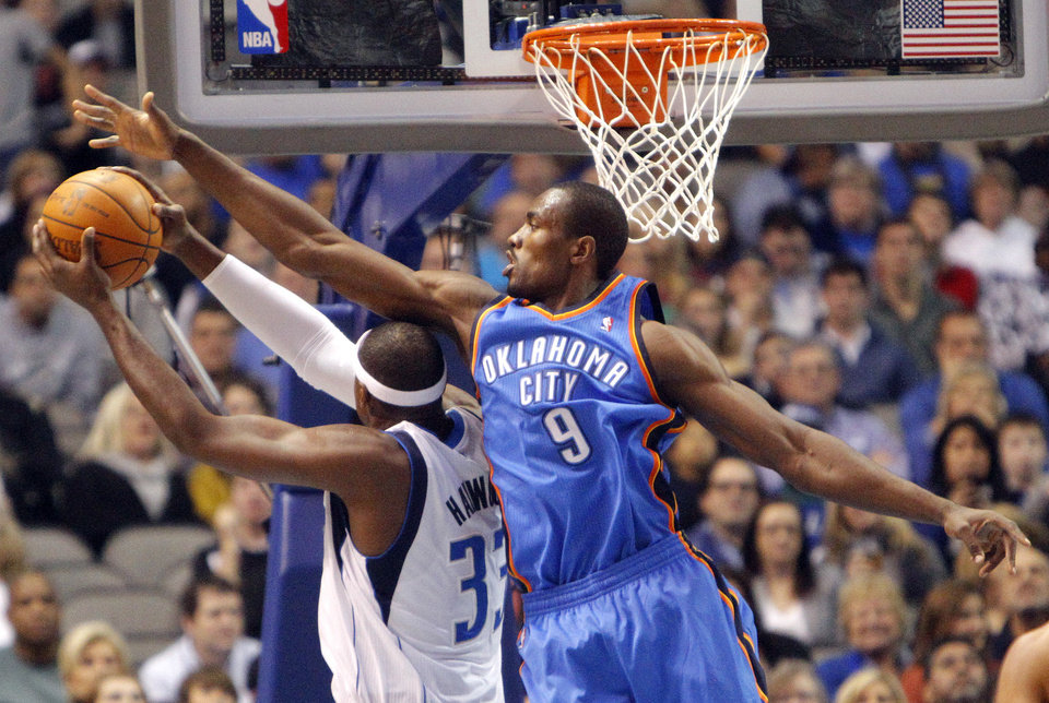 Oklahoma City's Serge Ibaka (9) tries to block Dallas' Brendan Haywood (33) during the pre season NBA game between the Dallas Mavericks and the Oklahoma City Thunder at the American Airlines Center in Dallas, Sunday, Dec. 18, 2011. Photo by Sarah Phipps, The Oklahoman