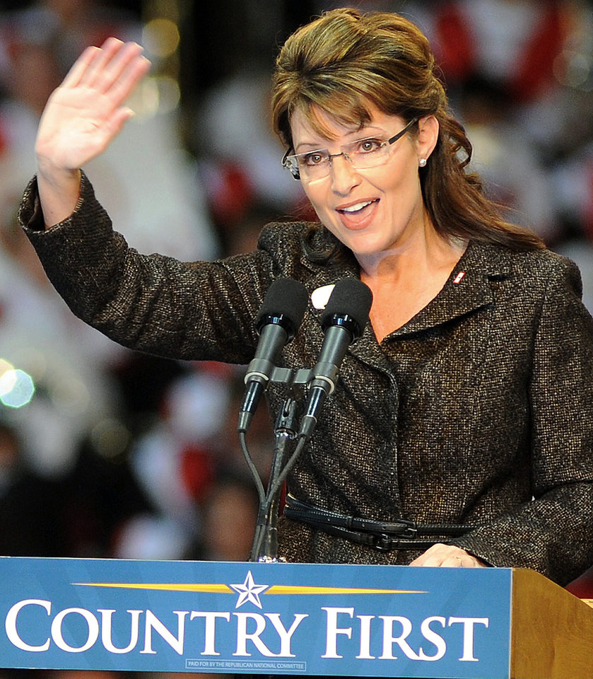 Photo - Alaska Gov. and Republican vice presidential candidate Sarah Palin waves to supporters during a rally at Hobart Arena, in Troy, Ohio, on Thursday, Oct. 23, 2008.  (AP Photo/Piqua Daily Call, Mike Ullery) ORG XMIT: OHPIQ101