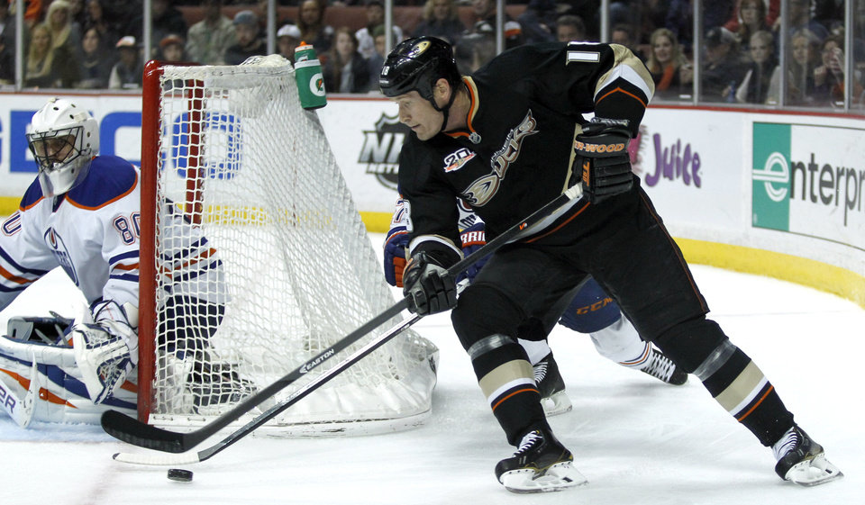 Photo - Anaheim Ducks right wing Tim Jackman (18) drives the puck for a shot against Edmonton Oilers goalie Ilya Bryzgalov (80), of Russia during the second period of an NHL hockey game Friday, Jan. 3, 2014, in Los Angeles.  (AP Photo/Alex Gallardo)