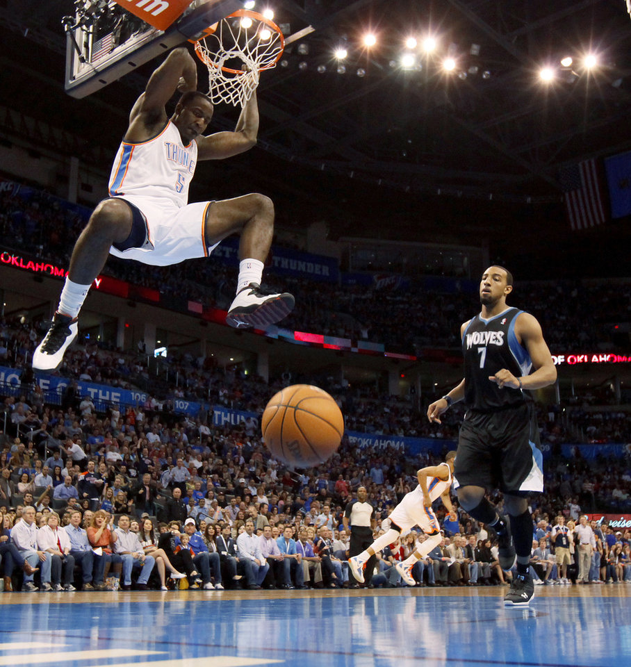 Photo - Oklahoma City's Kendrick Perkins (5) dunks the ball beside Minnesota's Derrick Williams (7) during the NBA basketball game between the Oklahoma City Thunder and the Minnesota Timberwolves at Chesapeake Energy Arena in Oklahoma City, Friday, March 23, 2012. Photo by Bryan Terry, The Oklahoman