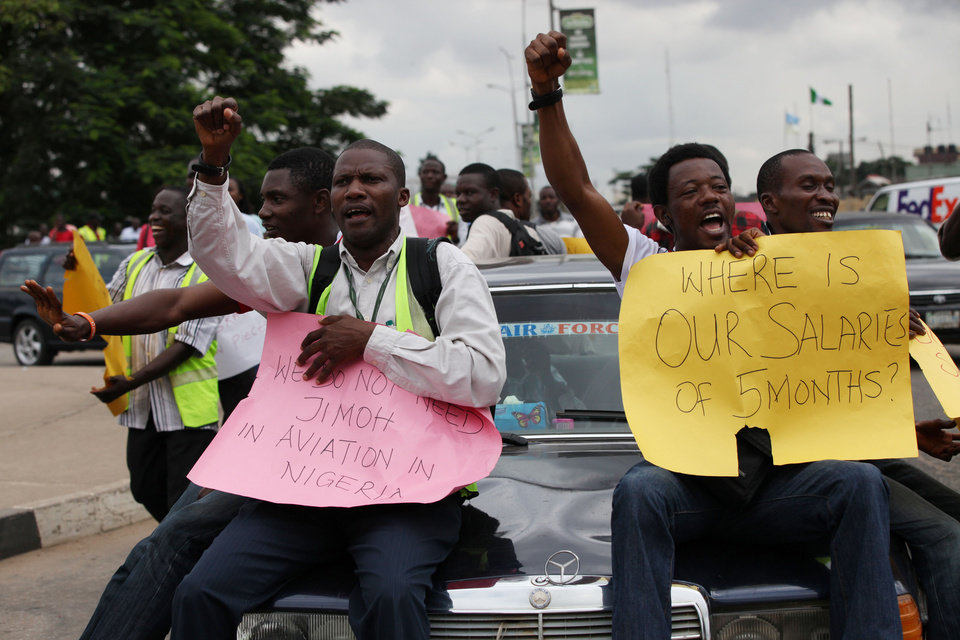 """Photo -   Former Air Nigeria staff protest after they were fired in Lagos, Nigeria, Friday, Sept. 7, 2012. More than 60 workers from Air Nigeria protested Friday at Lagos' Murtala Muhammed International Airport's domestic terminal, demanding four-months-worth of unpaid salaries from the company. The airline's owner, business tycoon Jimoh Ibrahim, fired nearly all of the company's 800 employees for """"disloyalty"""" earlier this month. (AP Photo/Sunday Alamba)"""